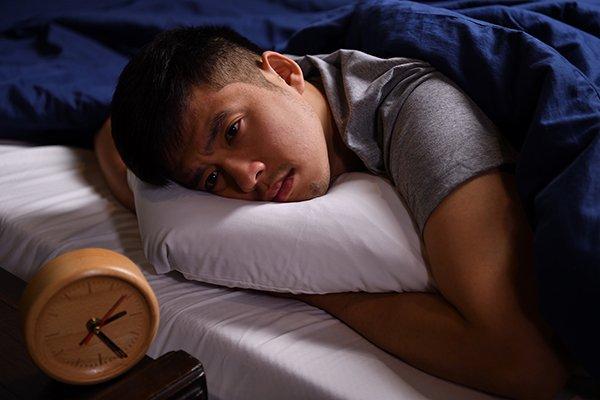 man trying to sleep